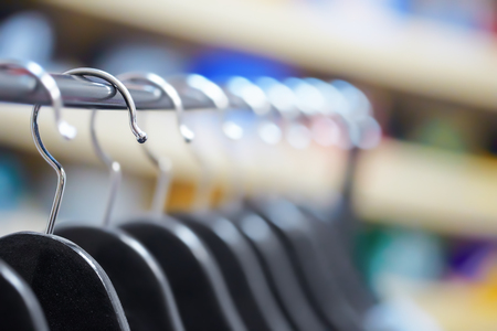 drycleaning: Hangers at a clothing store