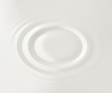 Milk. Circles on the surface of the milk 스톡 콘텐츠