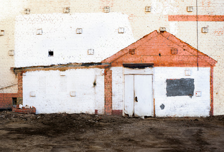 hypothec: Traces of the demolished house on a brick wall Stock Photo
