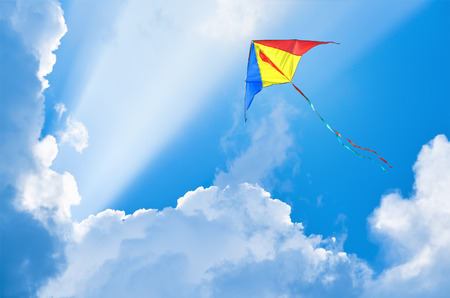 aloft: Kite flying in the sky among the clouds