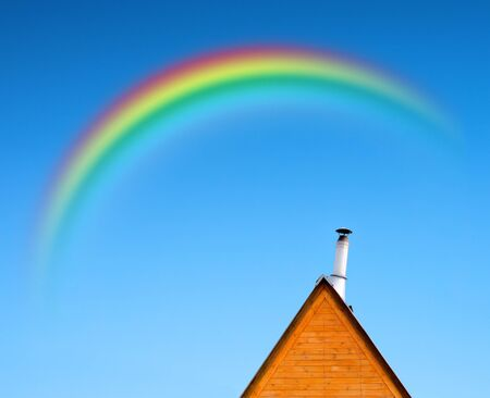 roof of the house with trumpet and rainbow on blue sky Stock Photo