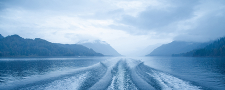 Trace from boat on the surface of lake with. Altai, Lake Teletskoye.