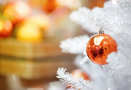 red ball hanging from a decorated сhristmas tree Stock Photo