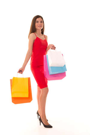 Beautiful girl in heels stands with packages. Stock Photo