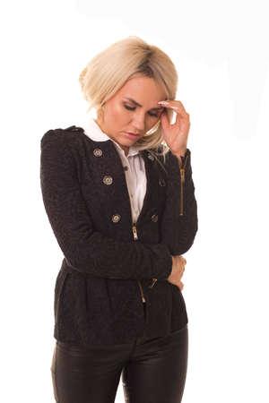 Sad girl bent her head down and is sad.