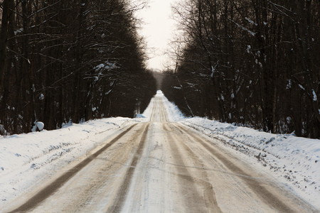 empty winter road with traces of emergency braking Stock Photo