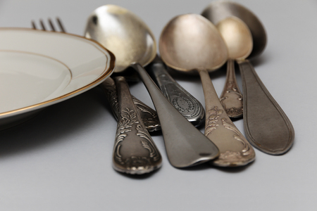 old silver cutlery mixed: knife, spoons, forks and dish piece