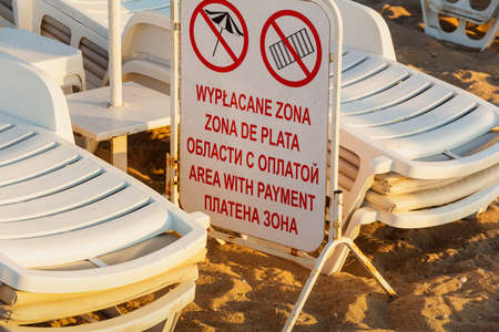 Information board about the paid beach area. Use of private umbrellas and sun beds is prohibited