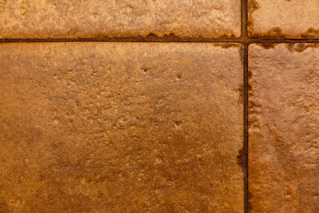 texture of yellow brown ceramic tiles with joints and seam