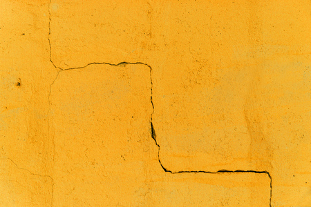 winding Deep Crack on Yellow Wall. abstract backdrop