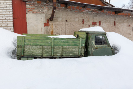 old snow car with a green wooden body and a metal cabin Reklamní fotografie
