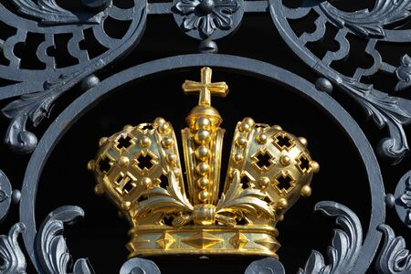golden crown on the gate - a symbol of the monarch