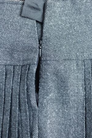 broken and jammed zipper on a woolen skirt. repair of clothes in the studio and sewing concept