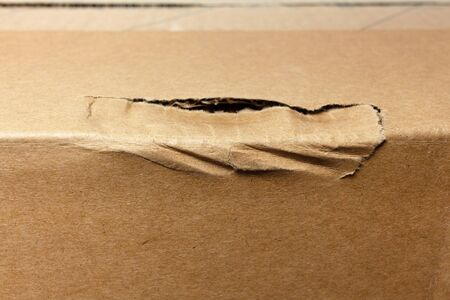damaged rumpled edge of the cardboard box during delivery. cargo insurance concept