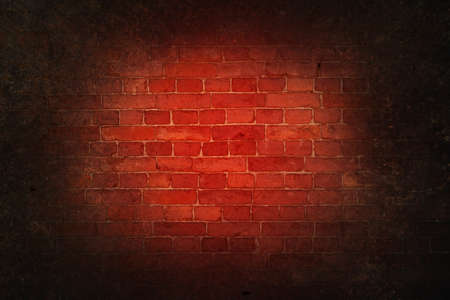 Gloomy bloody background scary red bricks of an old wall with dark vignette