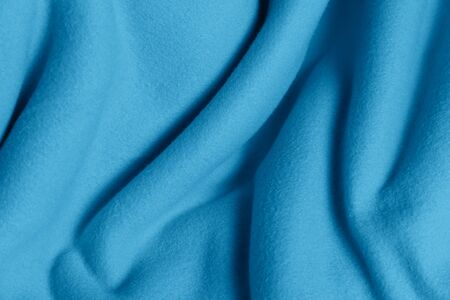Delicate background of light blue soft plush fleece with embossed folds and waves. A modern backdrop for decorating and designing textiles. 版權商用圖片