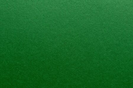 green cardboard sheet. Paper texture for graphics and design.