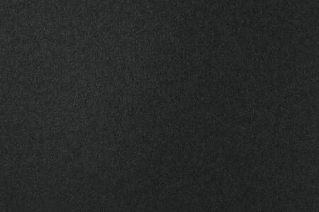 Deep black color of a blank sheet of paper with gradient. Gloomy background for text and design. 版權商用圖片 - 145047641