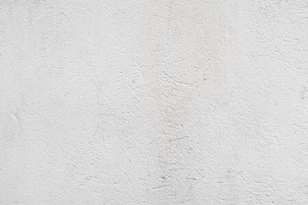 Stucco texture of an empty white painted concrete wall. Industrial architectural background 版權商用圖片