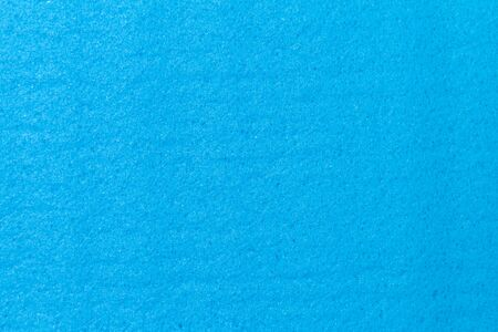 texture of a new clean blue viscose cloth for cleaning and household chores.