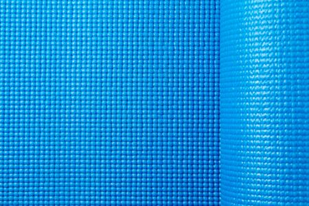 texture of a sports yoga mat in blue. sports and health - home workouts
