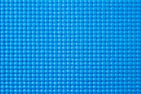Yoga mat texture. empty blue sport background for banner, text or poster