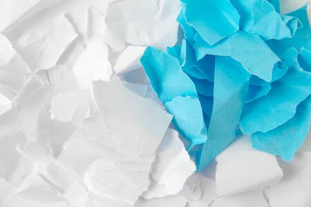 Pieces of torn white and blue paper for making papier mache 版權商用圖片