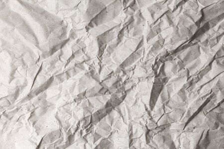 texture of gray crumpled wrapping paper with shadows and wrinkles 版權商用圖片