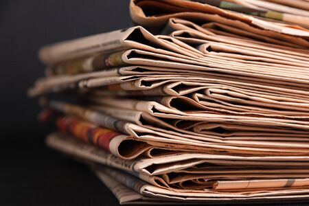 Pile of newspapers, concept of journalism, democracy and propaganda