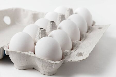 white chicken eggs in an open paper box