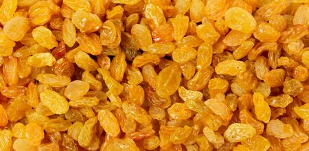 Golden raisins dried grapes as a background texture