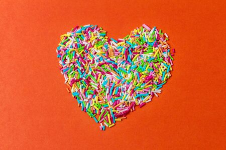 Heart shape made from multi-colored decorative confectionery sprinkles  版權商用圖片
