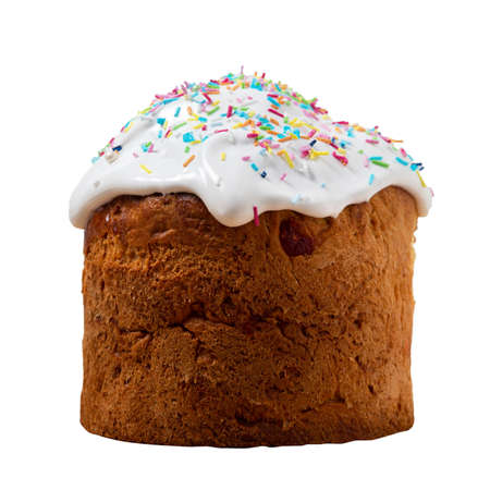 Festive Easter cake with white icing and multicolored sprinkles isolated on a white background. homemade holiday cakes 版權商用圖片
