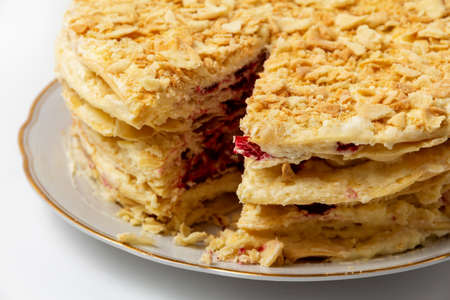 French layer cake Napoleon with cream and cranberries. Culinary background for cafe or restaurant menu