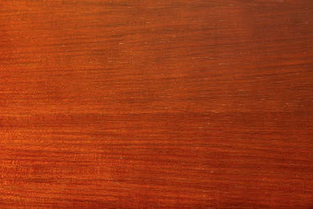 Bright brown texture of the wood surface of an aristocratic elegant old table with traces of varnish, cracks and gradient