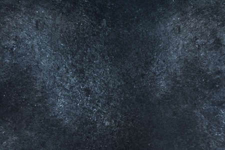 Dark grunge abstract texture with space for text. The grim surface of an old burned concrete wall or stone 版權商用圖片