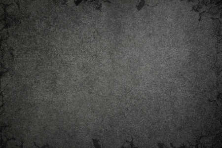 Texture of the old concrete wall with black cracks and gradient. Dark industrial background for banners, design and text. 版權商用圖片