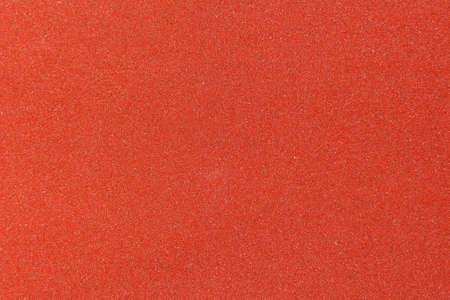 Red sandpaper texture background for design