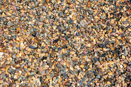 Multicolored granite stones and gravel rubble close up