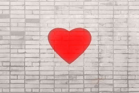 Big red heart on a gray brick wall. The concept of health and the struggle of doctors for the lives of patients Archivio Fotografico
