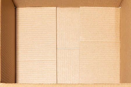 The bottom is an empty open brown cardboard box. Concept of insurance of mailings and online purchases
