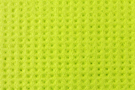 Textured surface of a new clean green cloth for wiping and cleaning 版權商用圖片