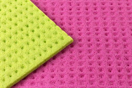 Close-up of green and pink viscose napkins