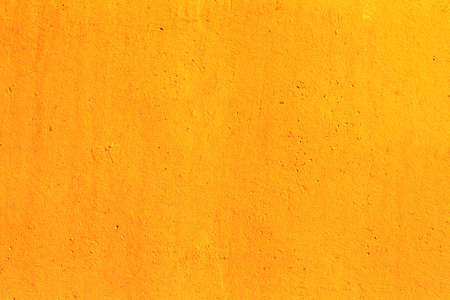 Bright gold orange grunge wall texture in classic style for advertising and design. Modern elegant backdrop for decoration 版權商用圖片