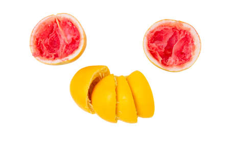 Halves of squeezed grapefruits and oranges on a white background in the form of a face
