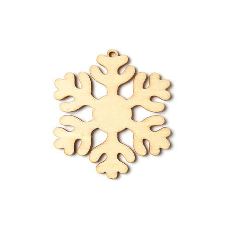 Snowflake carved from wood on a white background. New Year and Christmas decorations