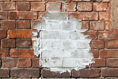 Cement patch on an old weathered red brick wall of a building. Classical architectural background
