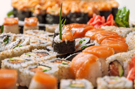 Appetizing sushi set from maki, rols, nigiri in closs-up Banque d'images