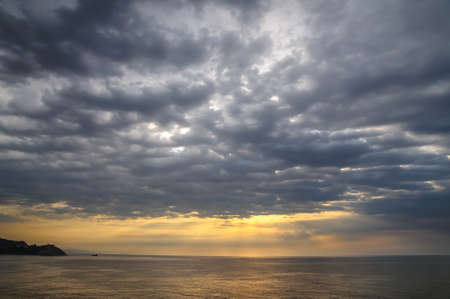 dramatic clouds over the sea at dawn