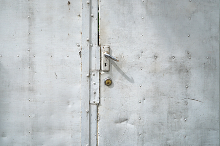 latch: stainless latch white door Stock Photo